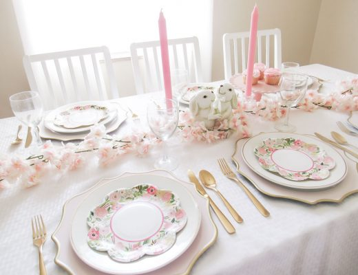 Easter Tablescape with cherry blossom table runner, pink candles and white bunnies
