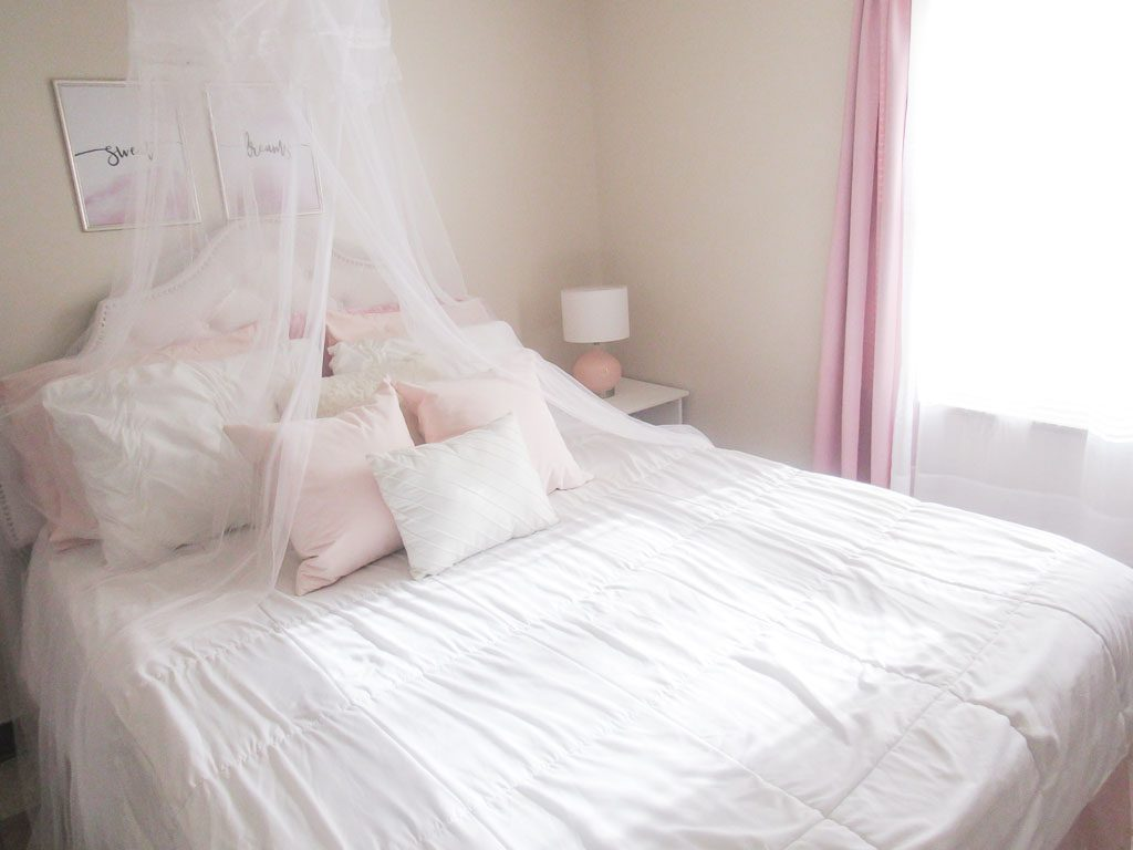 white bed with pink and white pillows