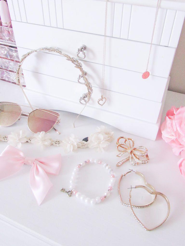 Feminine wardrobe accessories on a white dresser.
